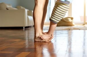 Seattle Home Inspection Toddler's feet over mom's feet