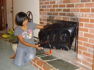 Seattle Home Inspection A Woman holding a fireplace plug
